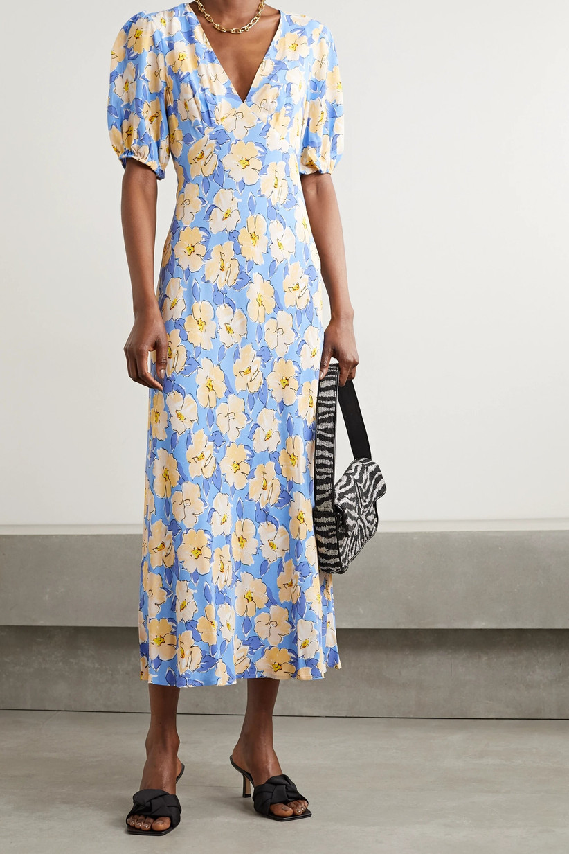Girl wearing a blue midi dress with yellow flower pattern
