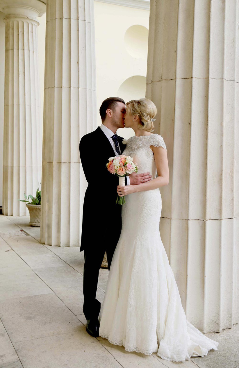 portrait-shot-of-bride-and-groom-kissing-2
