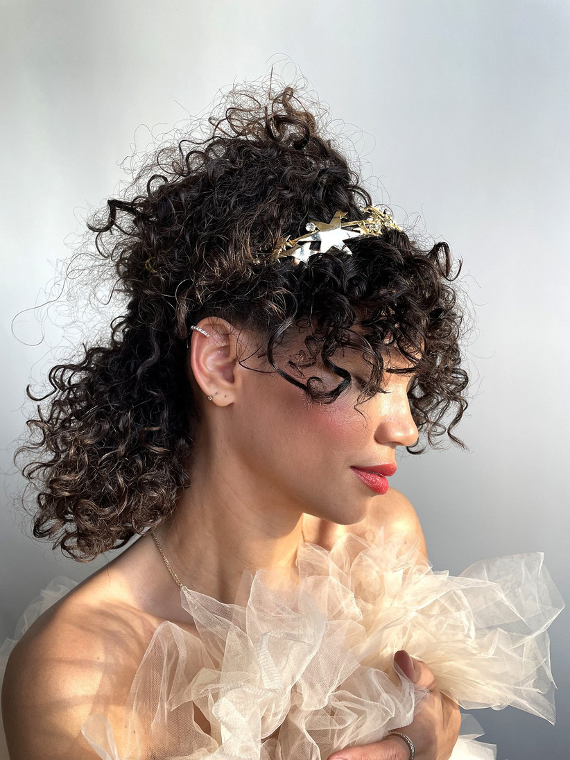 Curly half up half down hairstyle with a star head band