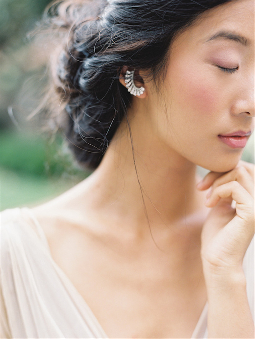 Natural looking bride closing her eyes