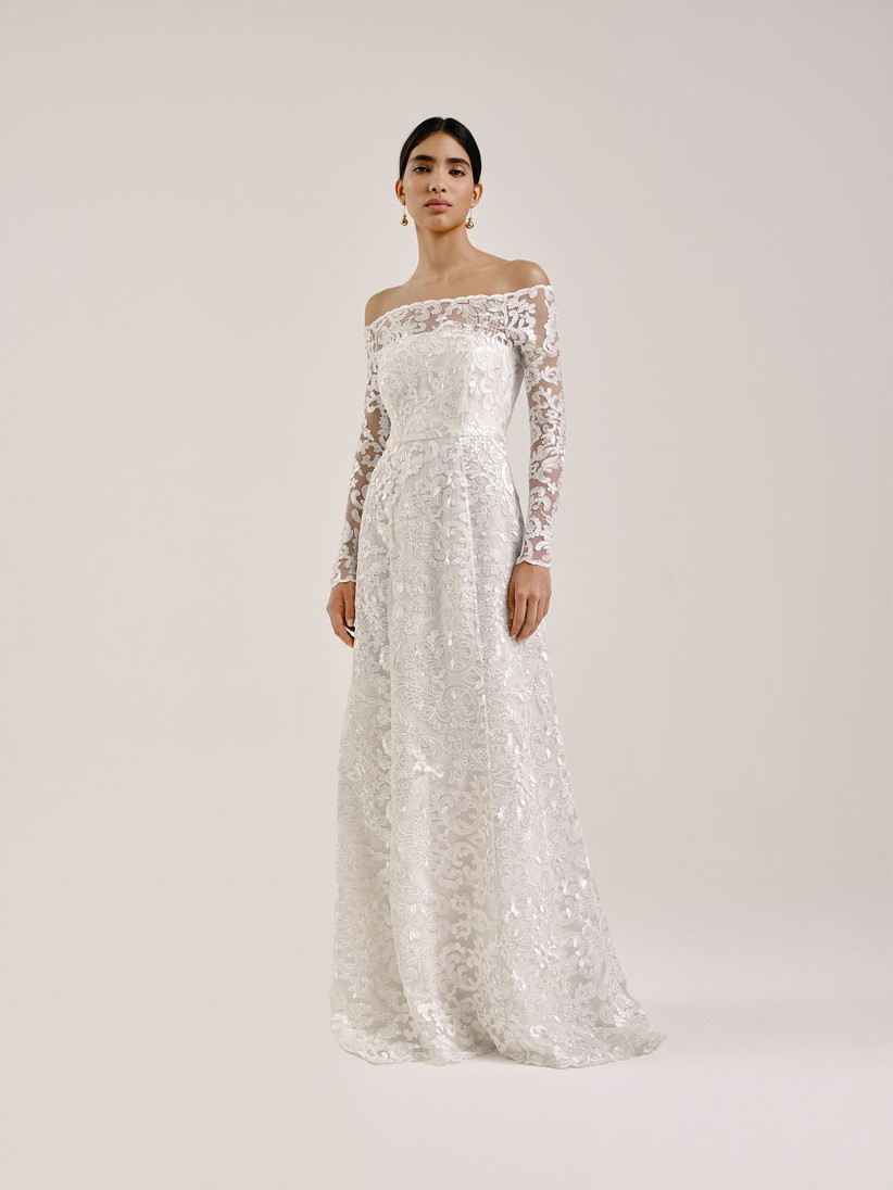Model wearing an off the shoulder lace wedding dress