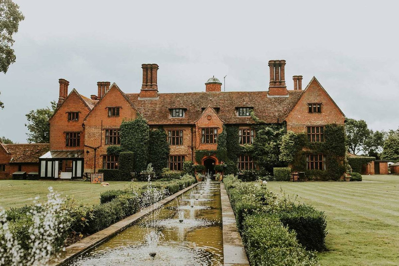 Manor house with a manicured garden and water features