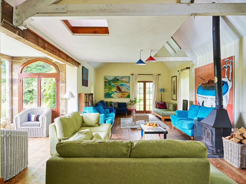Colourful living room with green and blue sofas