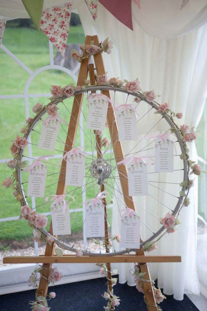 roses-wrapped-around-old-items-like-this-bicycle-wheel-table-plan-from-millbank-and-kent-is-a-great-way-to-give-your-summer-wedding-flowers-a-vintage-touch