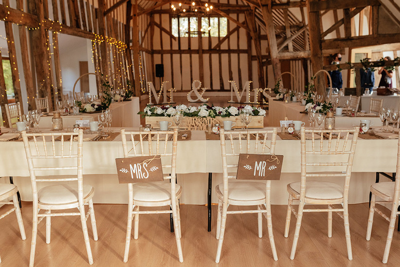 The barn dressed for the reception with fairy lights and a mr and mrs sign