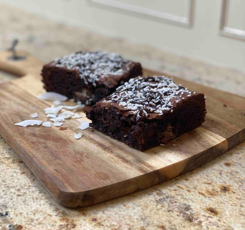coconut brownies on a chopping board