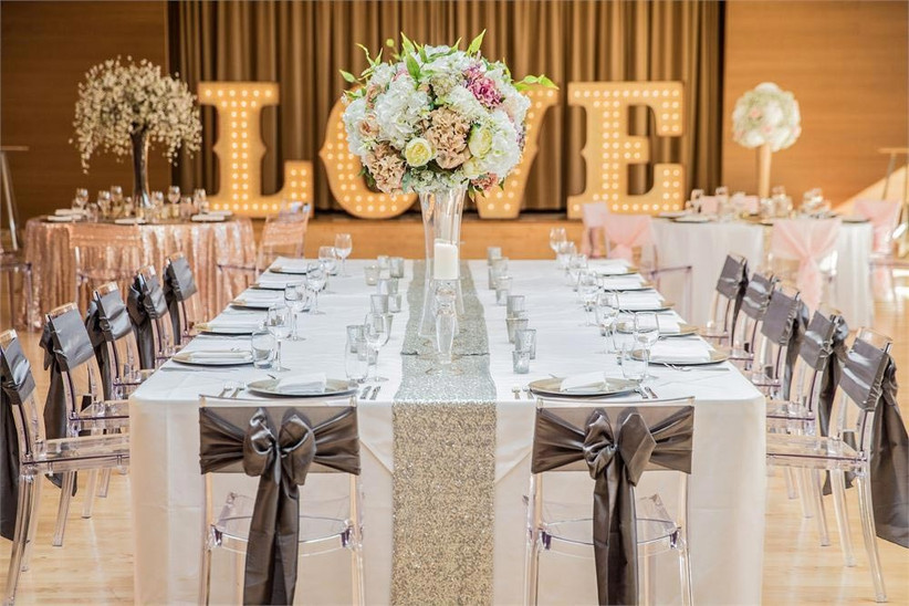 clear-chairs-decorated-with-grey-bows