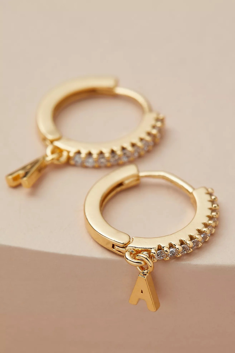 Small gold crystal embedded huge hoops with single drop letter