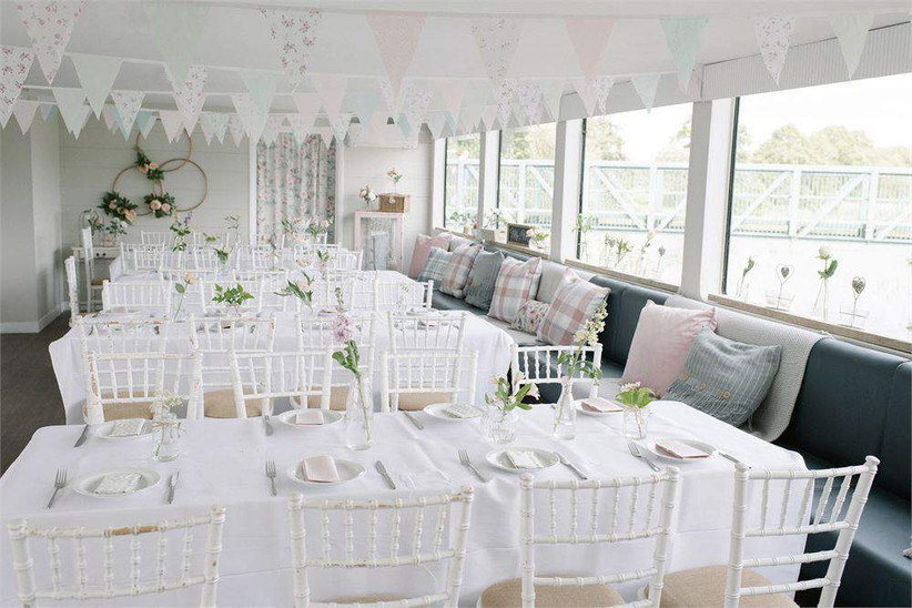Interior of Northamptonshire wedding venue The Ark dressed for a wedding with pastel bunting