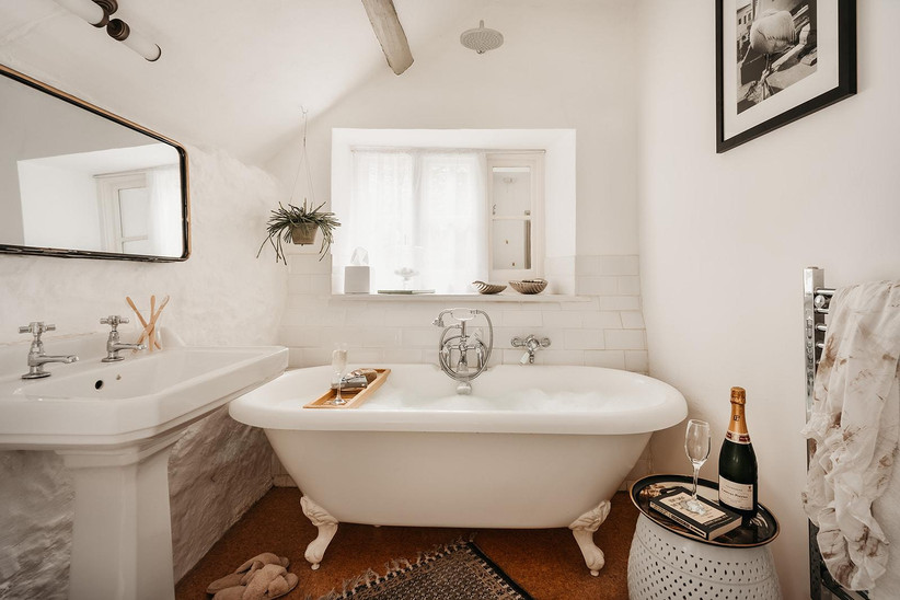 White bathroom with bubble bath