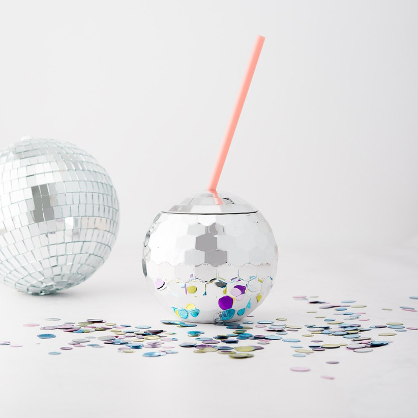 Disco ball tumbler with a pink straw