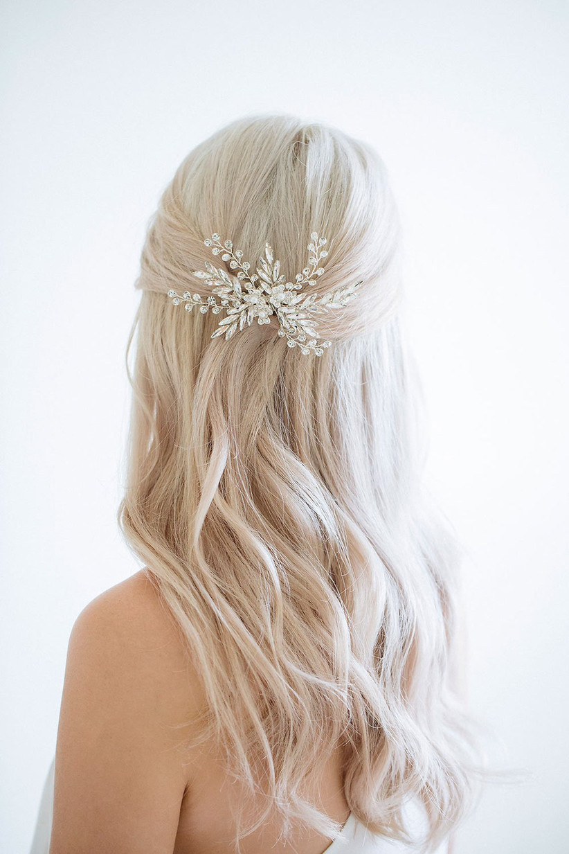 Half up half down hairstyle with a snowflake clip