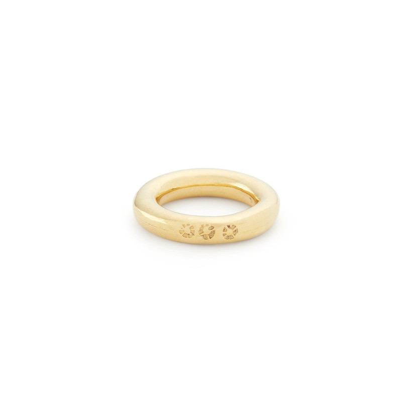 Thick gold ring stamped with the imprint of three suns