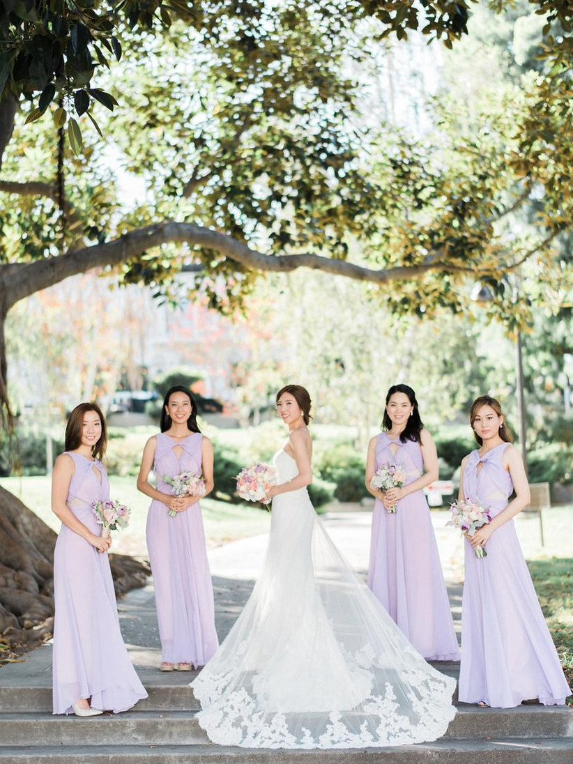 Bride and four bridesmaids standing two metres apart from each other