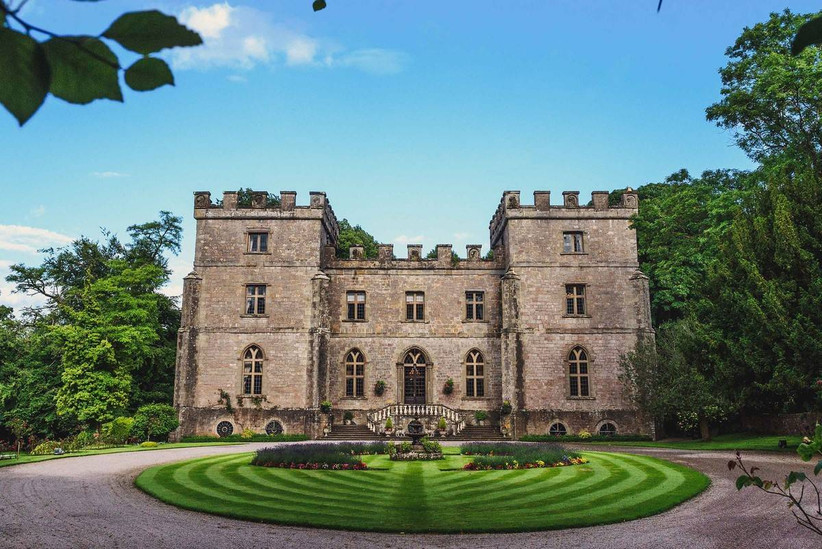 Outside view of a castle with manicured circular lawn