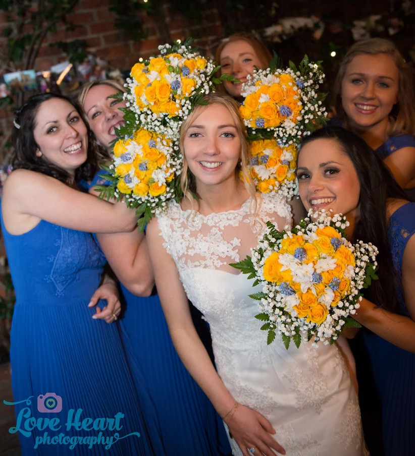 bride-and-bridesmaids-with-yellow-and-blue-spring-bouquets