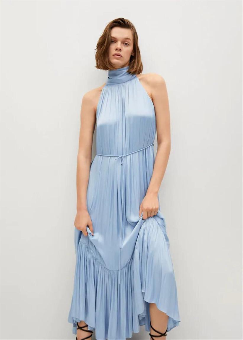 Girl wearing a light blue satin high neck dress