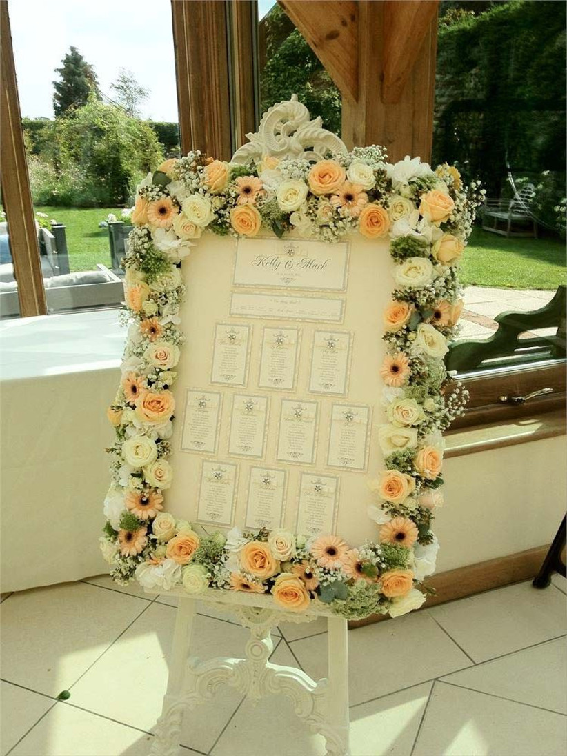 this-table-plan-from-designer-flowers-essex-is-framed-by-summer-wedding-flowers-in-a-colour-palette-of-peach-and-cream