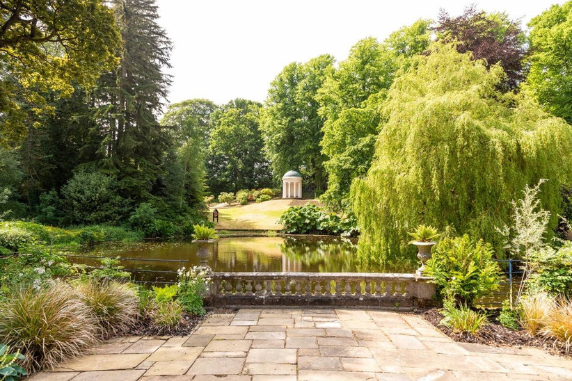 Beautiful gardens with a pond, weeping willow and pavilion