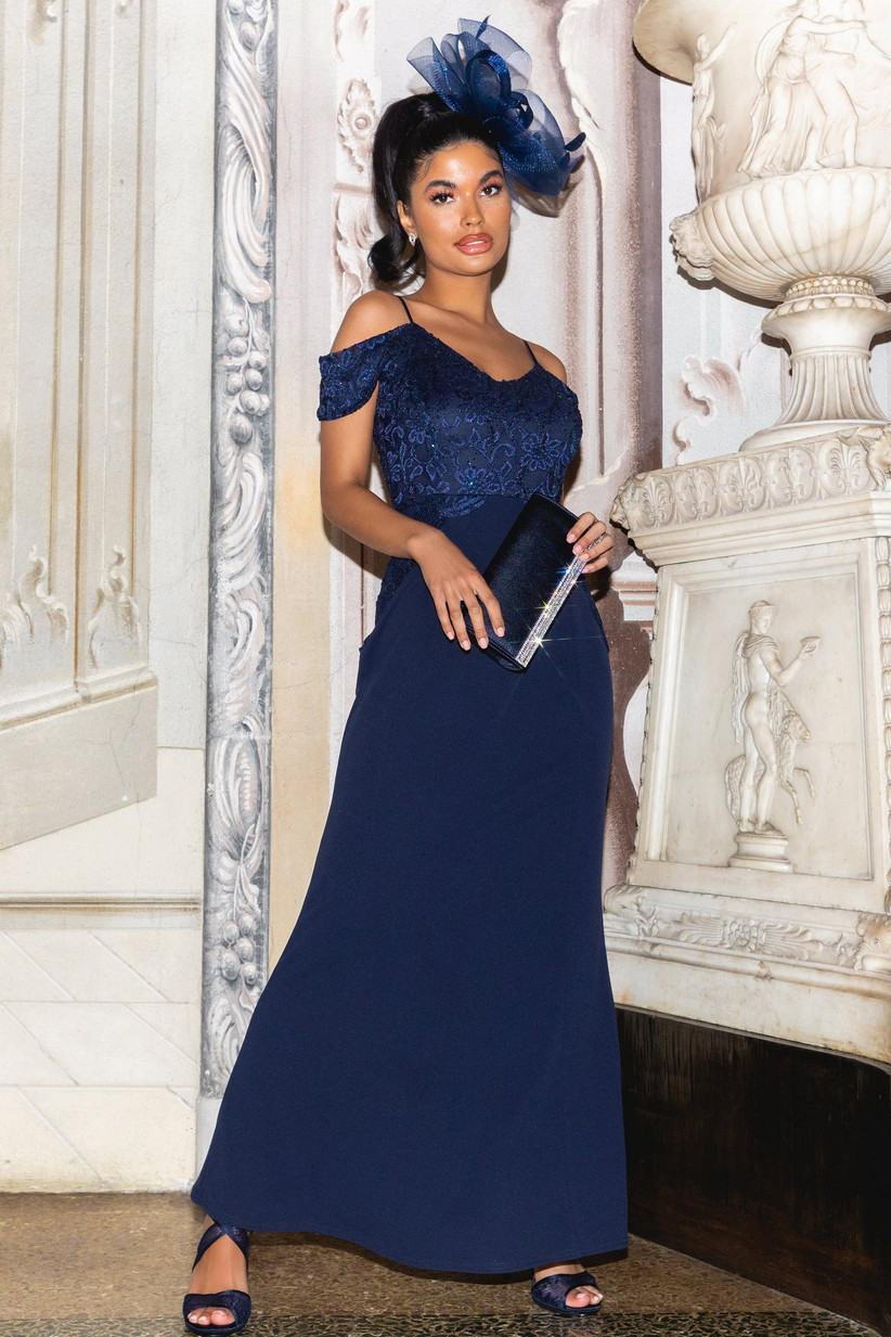 Girl wearing a lace and sequin navy maxi dress