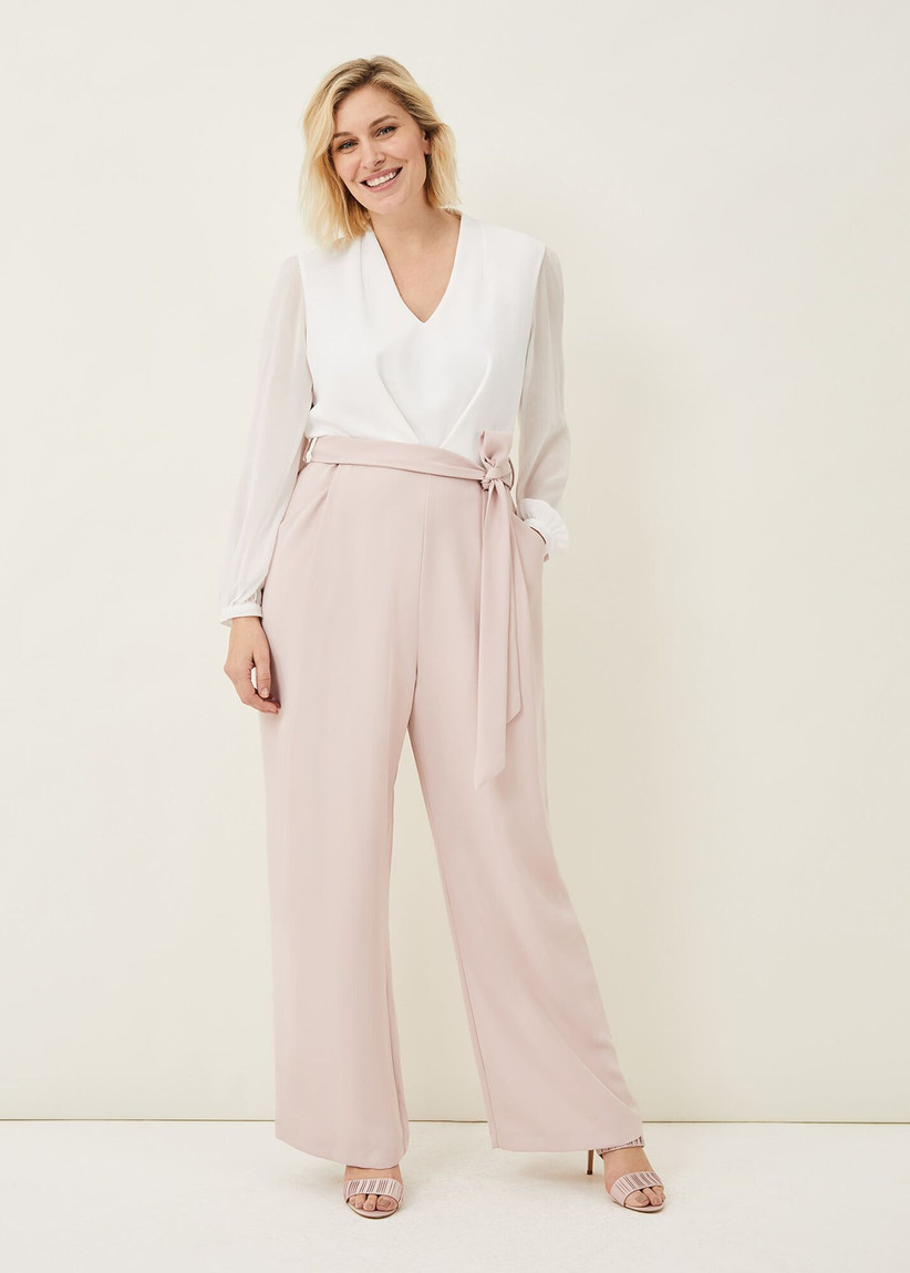 Jumpsuit with white long-sleeve top and pale pink trousers