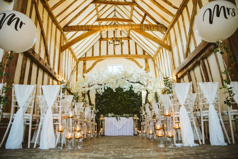 Rustic ceremony with candles and white floral decorations