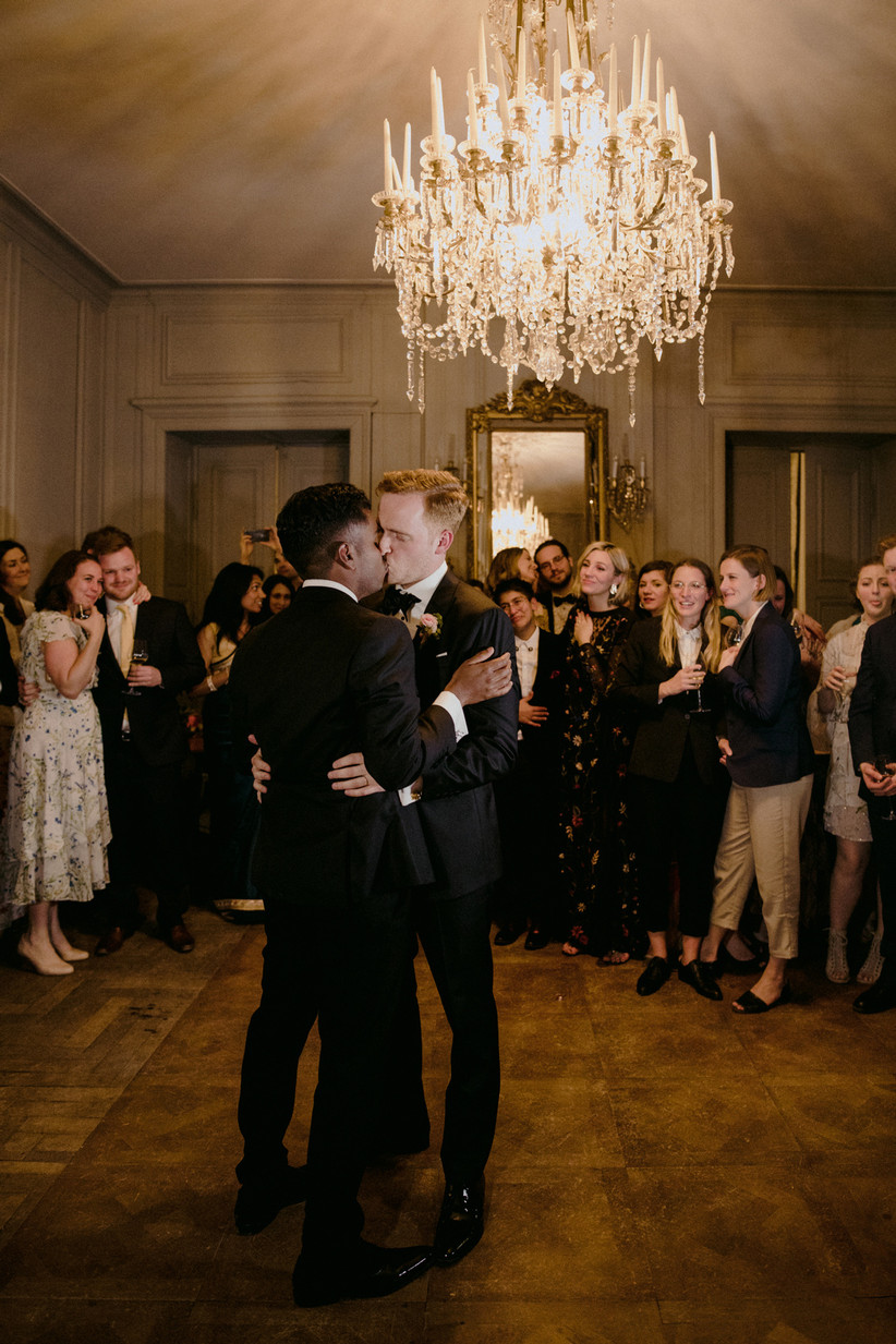 Newlywed grooms during their first dance