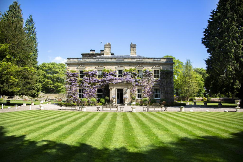 Exterior of Eshott Hall covered in wisteria