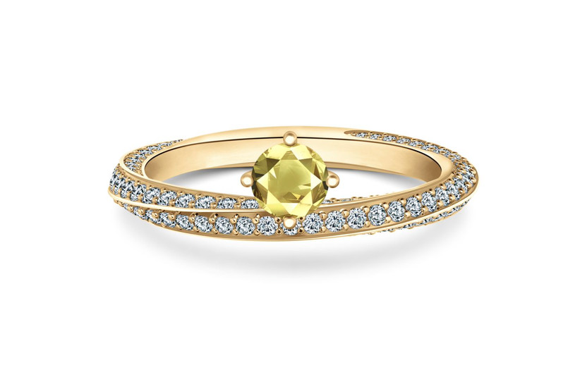 Twisted pave diamond gold band with a yellow sapphire suspended at the top of the ring