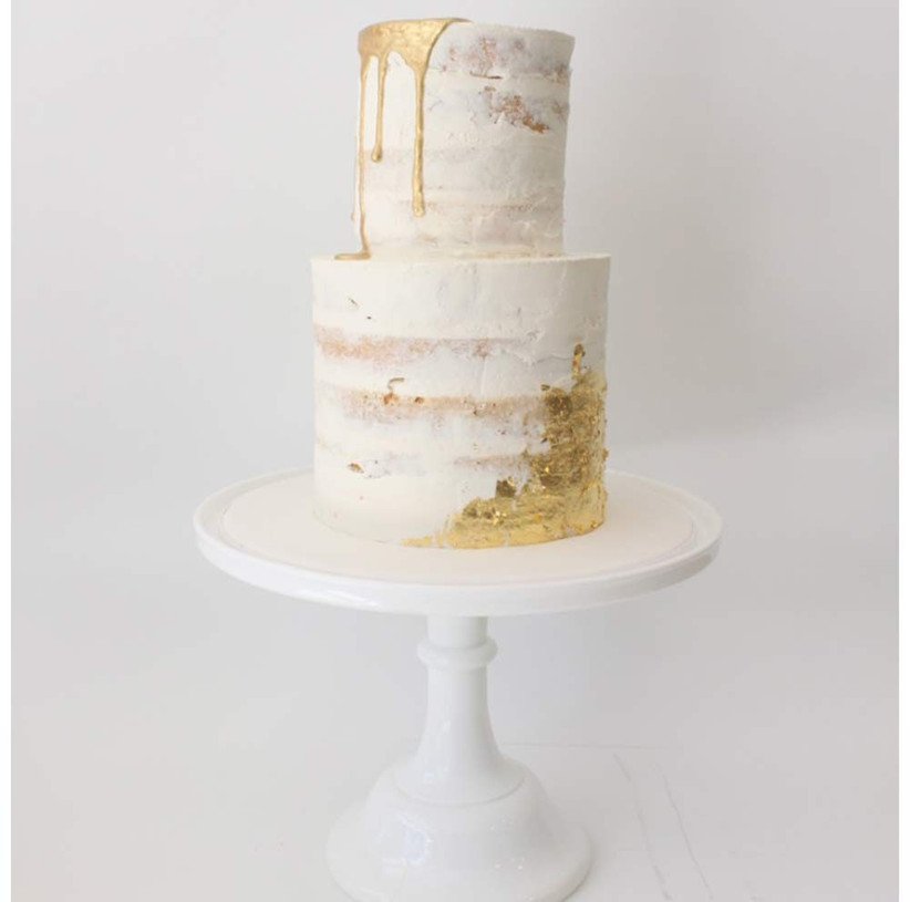 gold-and-white-drip-wedding-cake