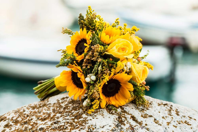 a-bouquet-filled-with-bright-seasonal-wedding-flowers-such-as-sunflowers-is-a-great-way-to-make-a-colour-statement-at-your-summer-wedding