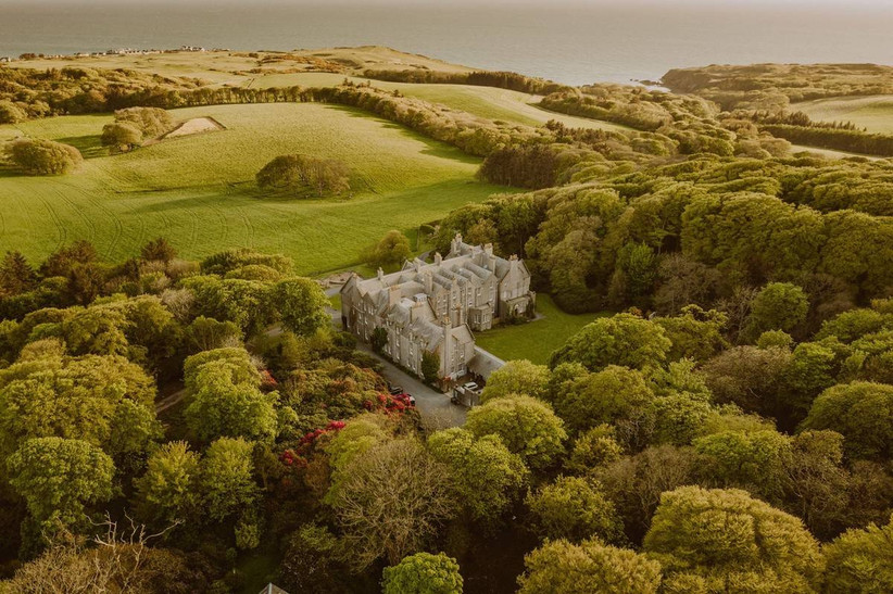 Bird's eye view of a castle surrounded by green countryside
