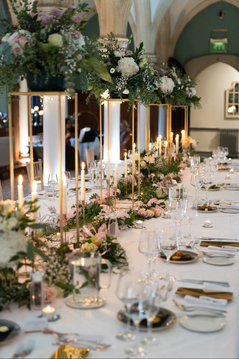 Wedding reception table with tall floral centrepieces