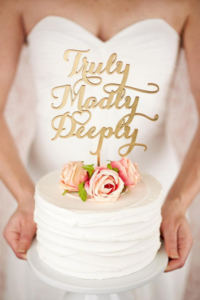 awesome-wedding-cake-toppers-for-tv-and-film-buffs-truly-madly-deeply-cake-topper