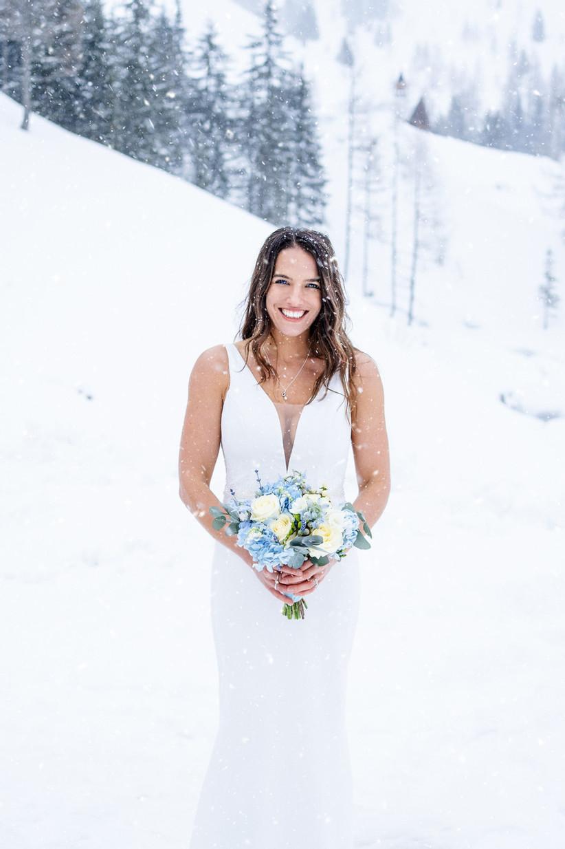 Bride posing in the snow