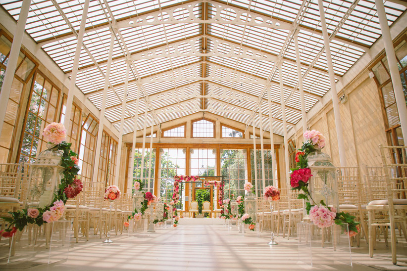Wedding aisle decorated with pink and red flowers