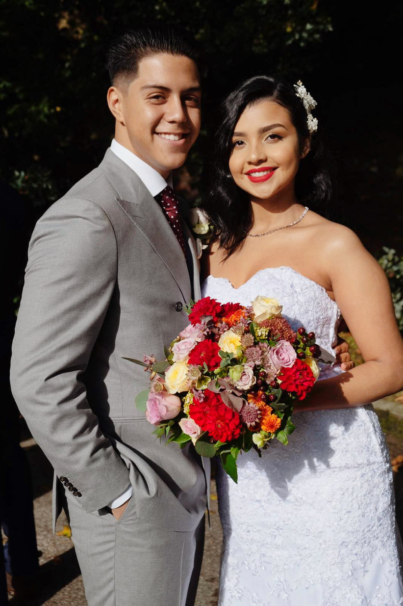 Jayson and Daniella in their wedding outfits