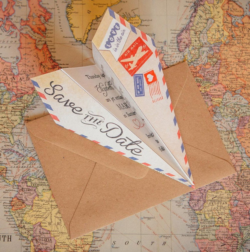 save-the-date-paper-aeroplane