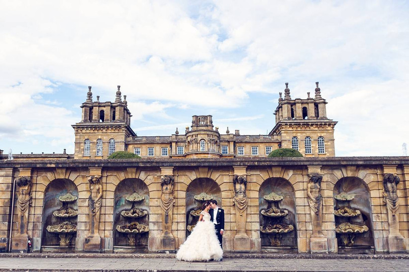 Bride and groom standing outside Blenheim Palace