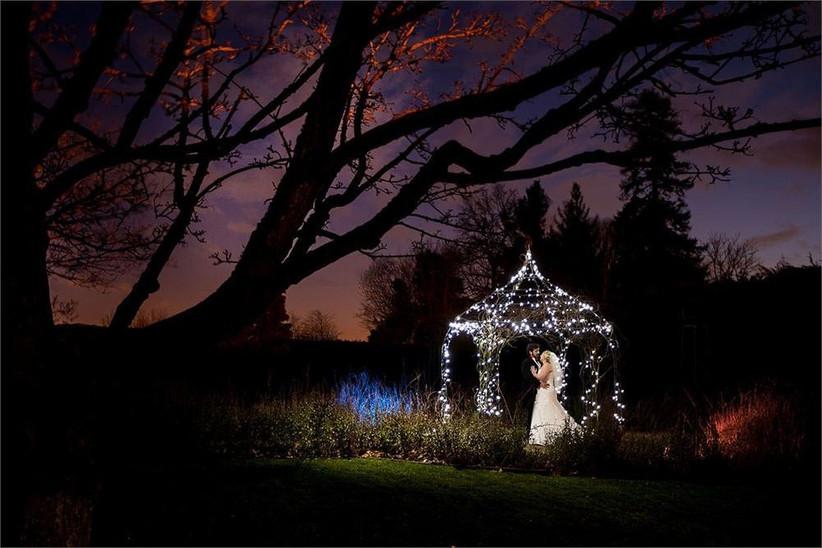 bride-and-groom-under-an-illuminated-gazebo-2