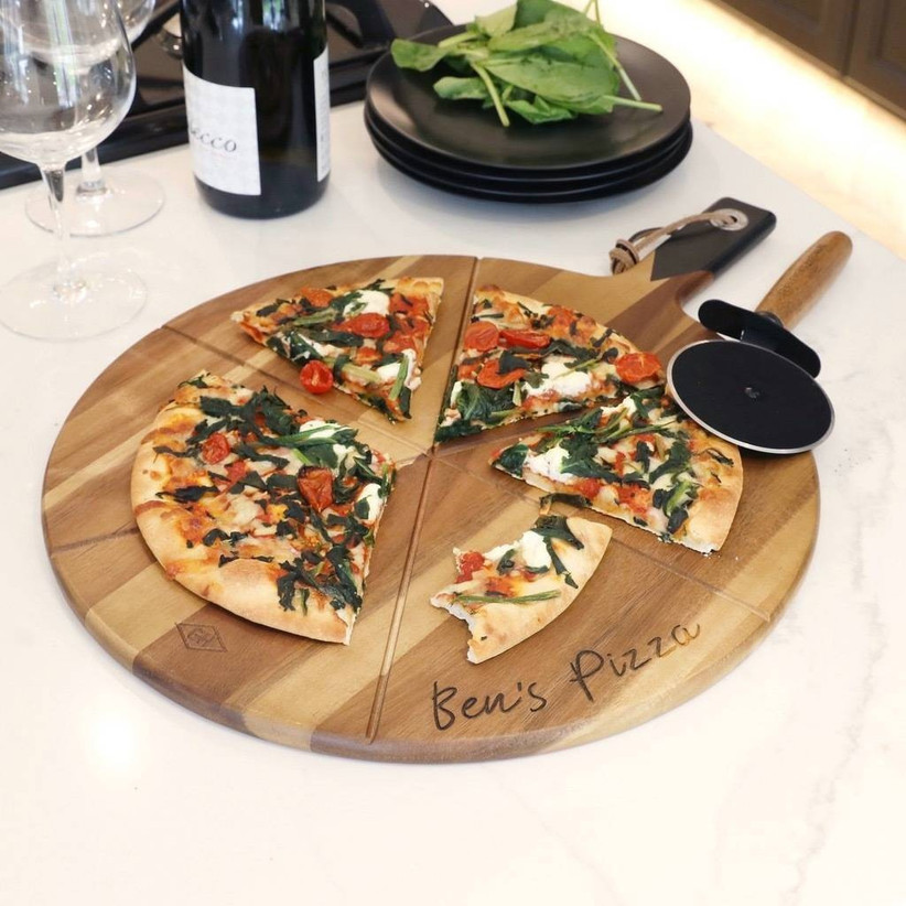 pizza board with a pizza cutter