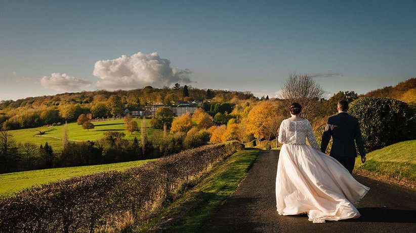 Bride and groom walking in the grounds of Wood Hall Hotel & Spa