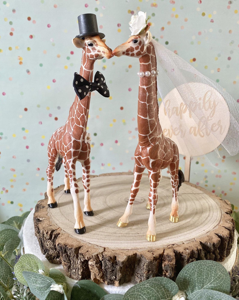 Giraffe wedding cake topper with veil, top hat and bow tie