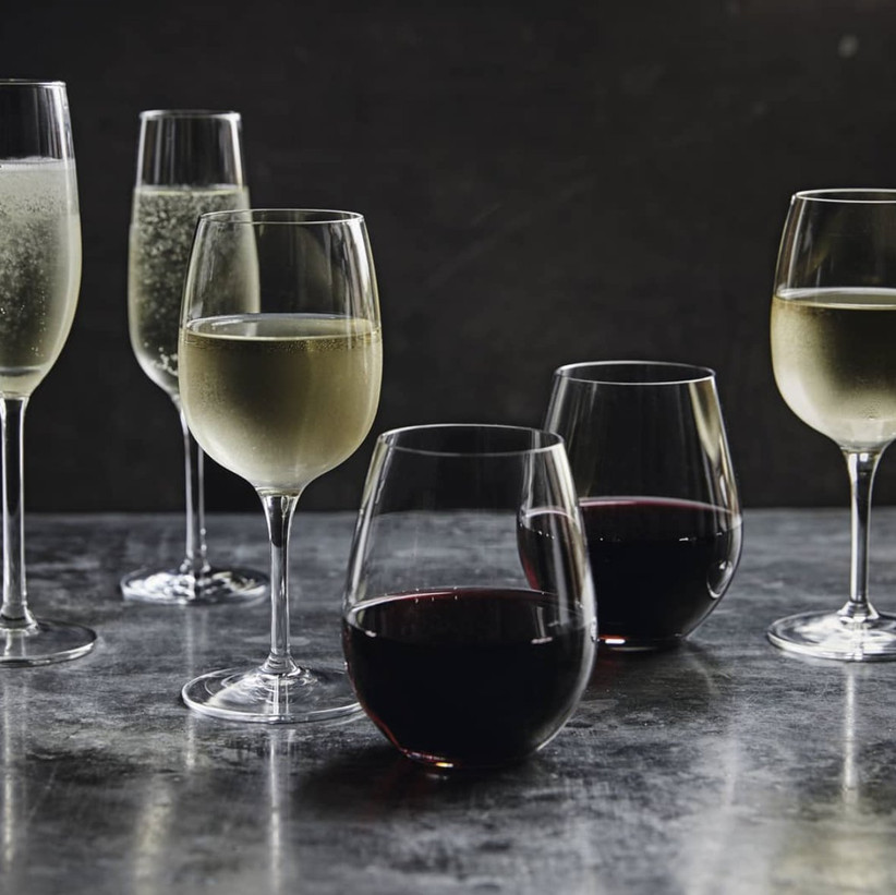 Marble table with various wines in different glasses on top