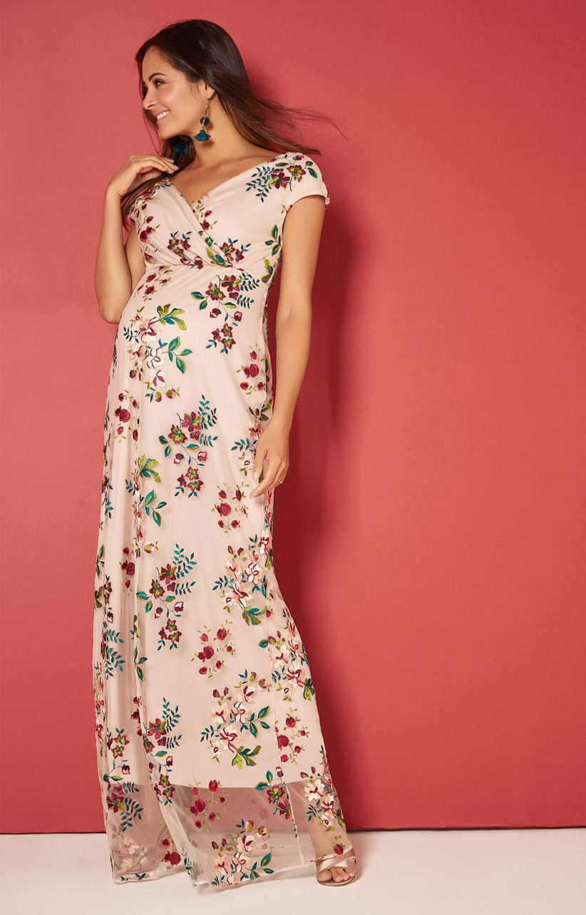 Model wearing floral maxi maternity dress