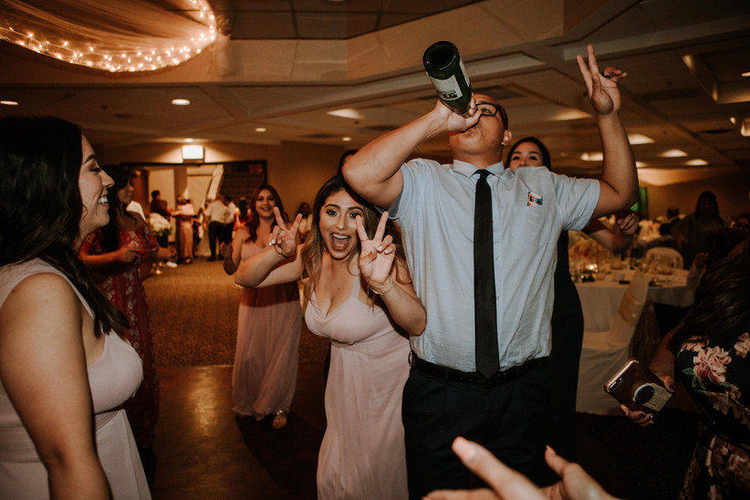 wedding guests drinking on dancefloor
