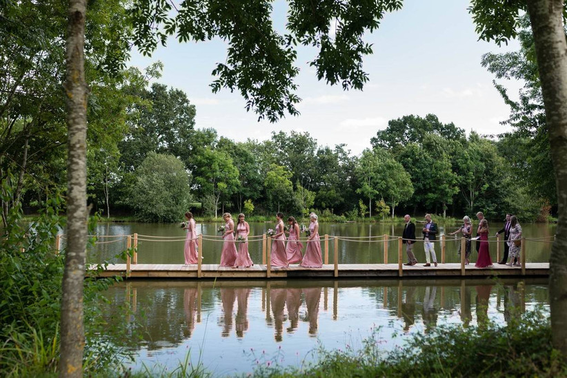 Wedding guests crossing a lake