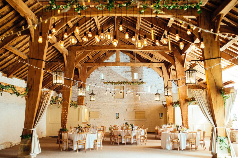 Wedding dining area in a wooden beam barn