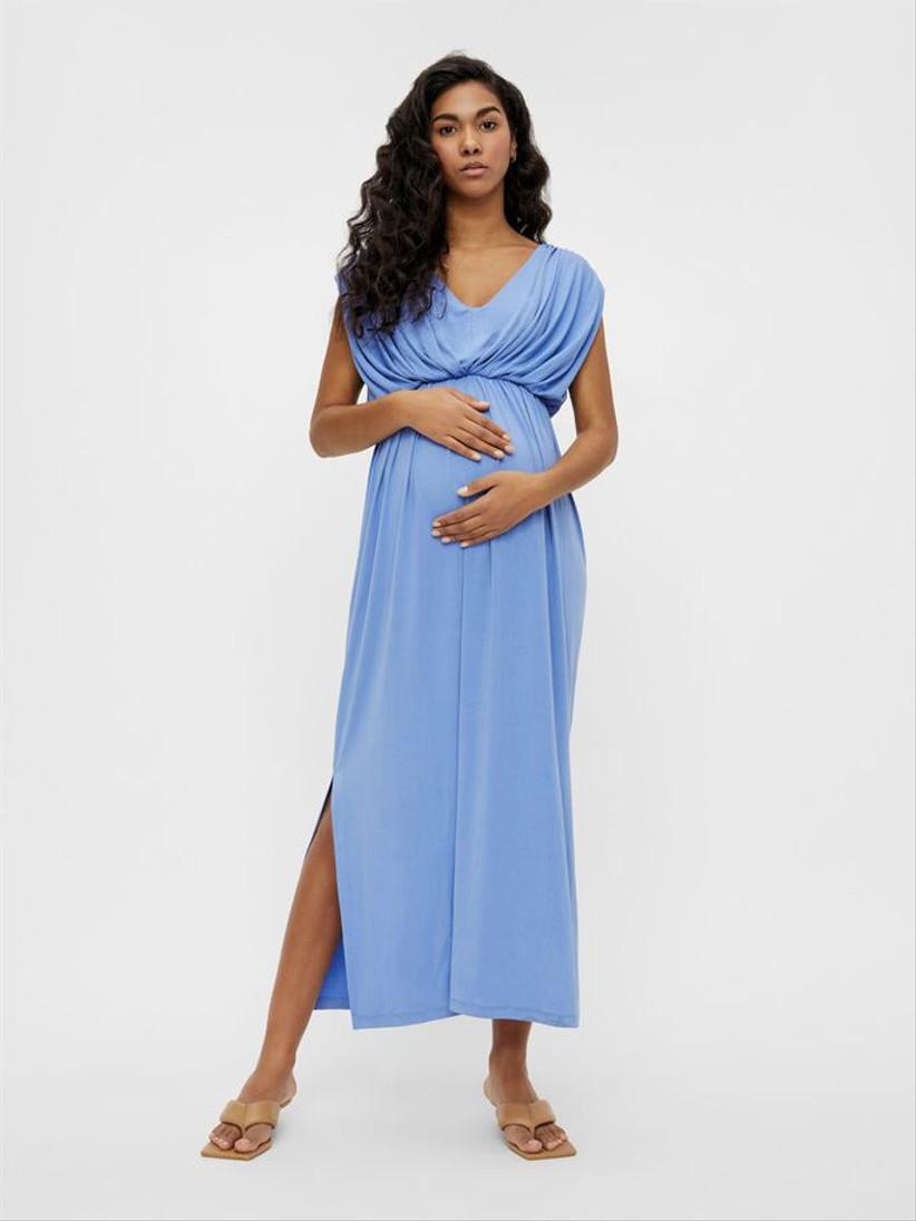 Pregnant model wearing a blue wedding guest dress