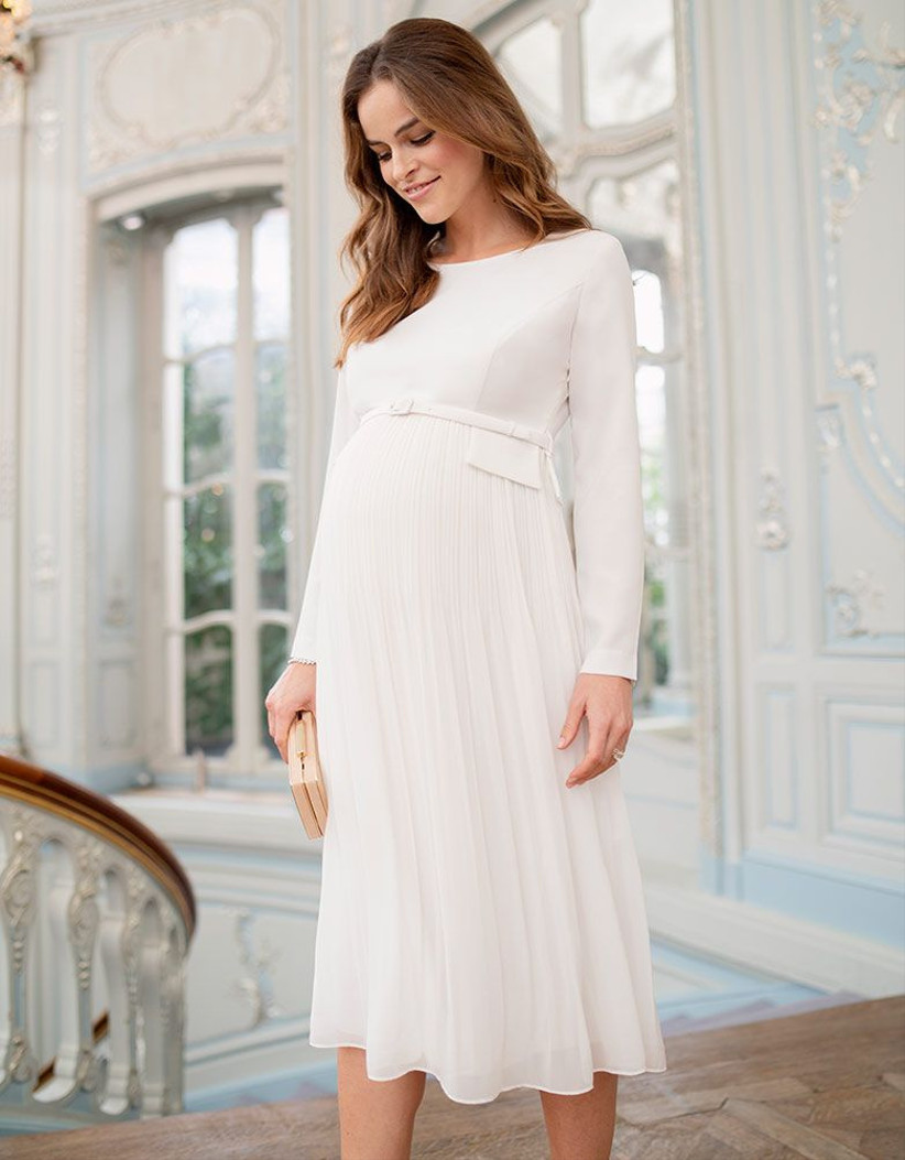 Model wearing midi maternity dress with pleated skirt